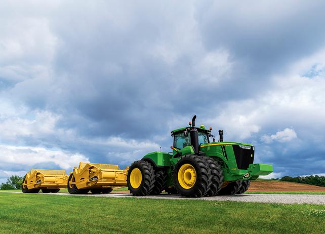 9620R Scraper Special Tractor with scraper attachments driving down a ...