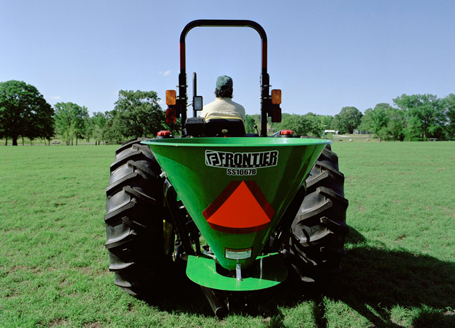 Rear view of a John Deere tractor with SS10B Series Broadcast Spreader ...