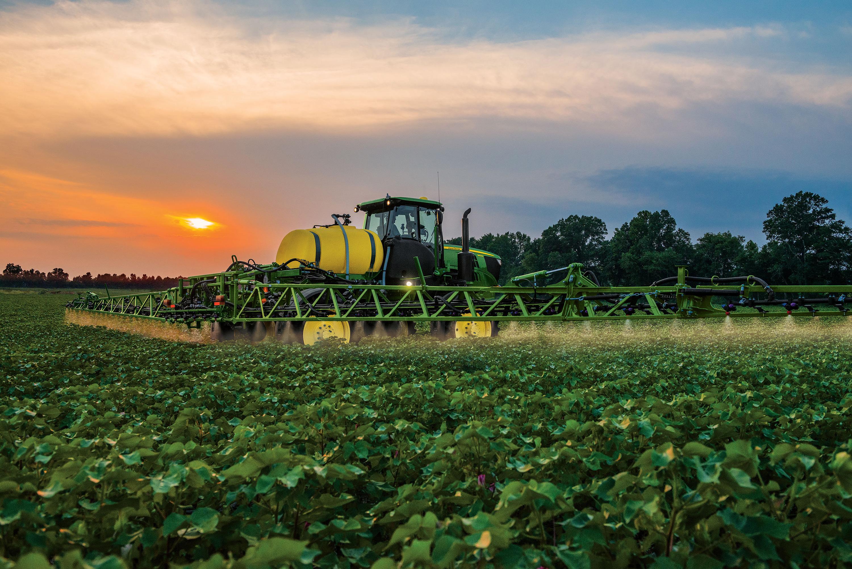 John Deere R4023 Sprayer in a field