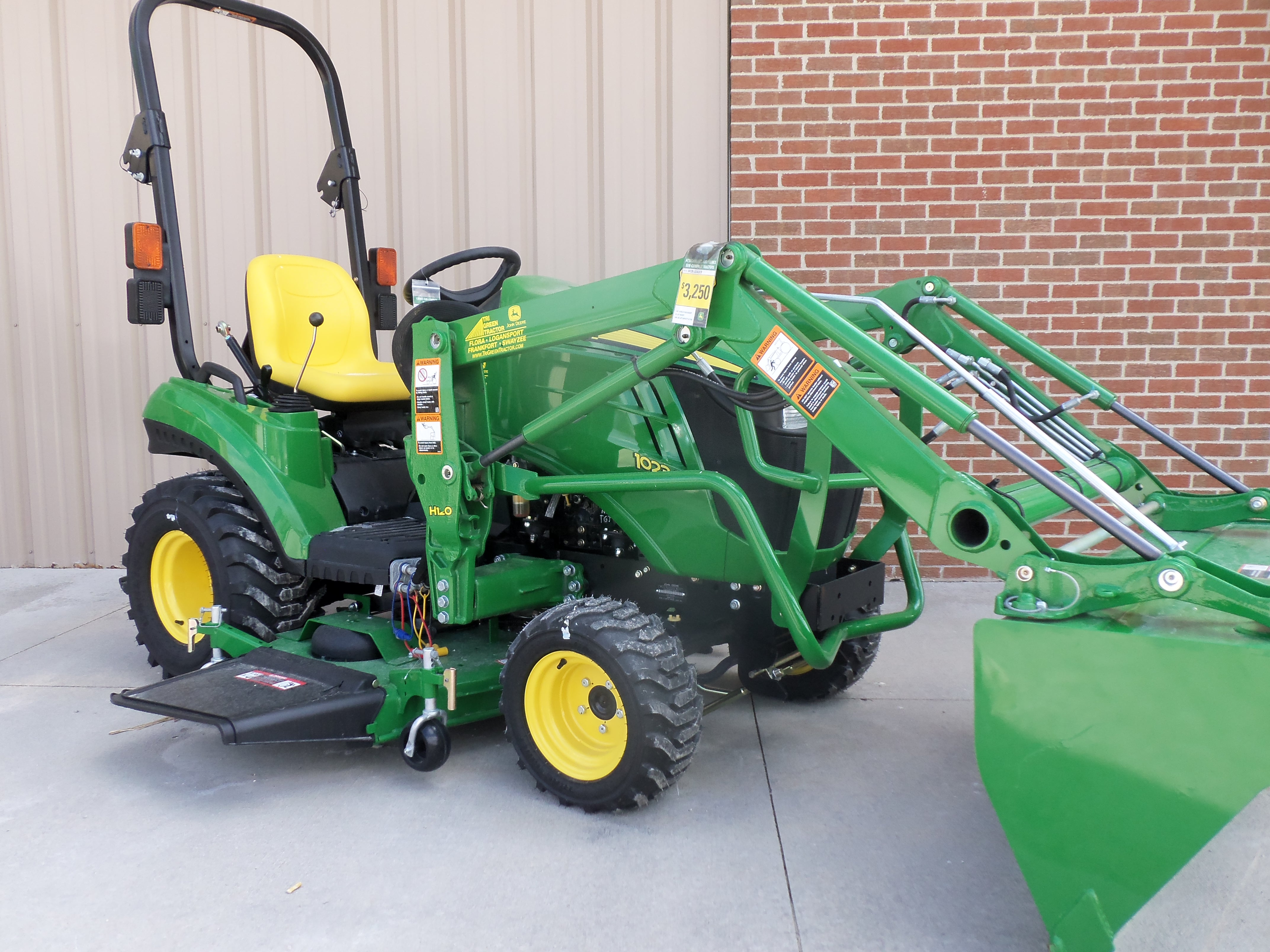 John Deere 1023E with H120 loader | Tri Green Tractor in Flora | Pin ...