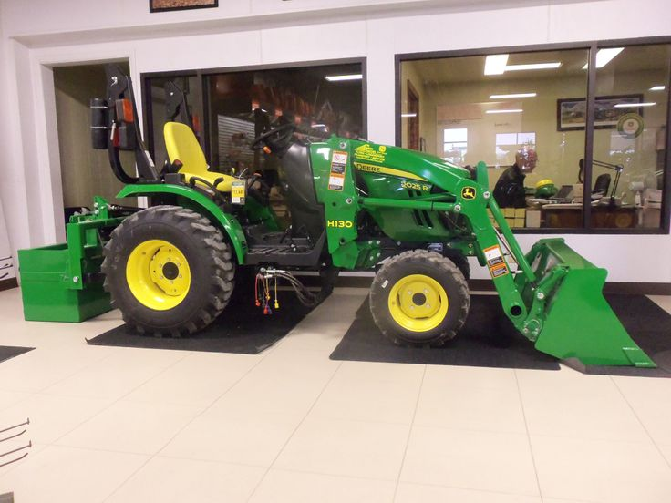 JOhn Deere 2025R with H120 loader inside Tri Green Tractor