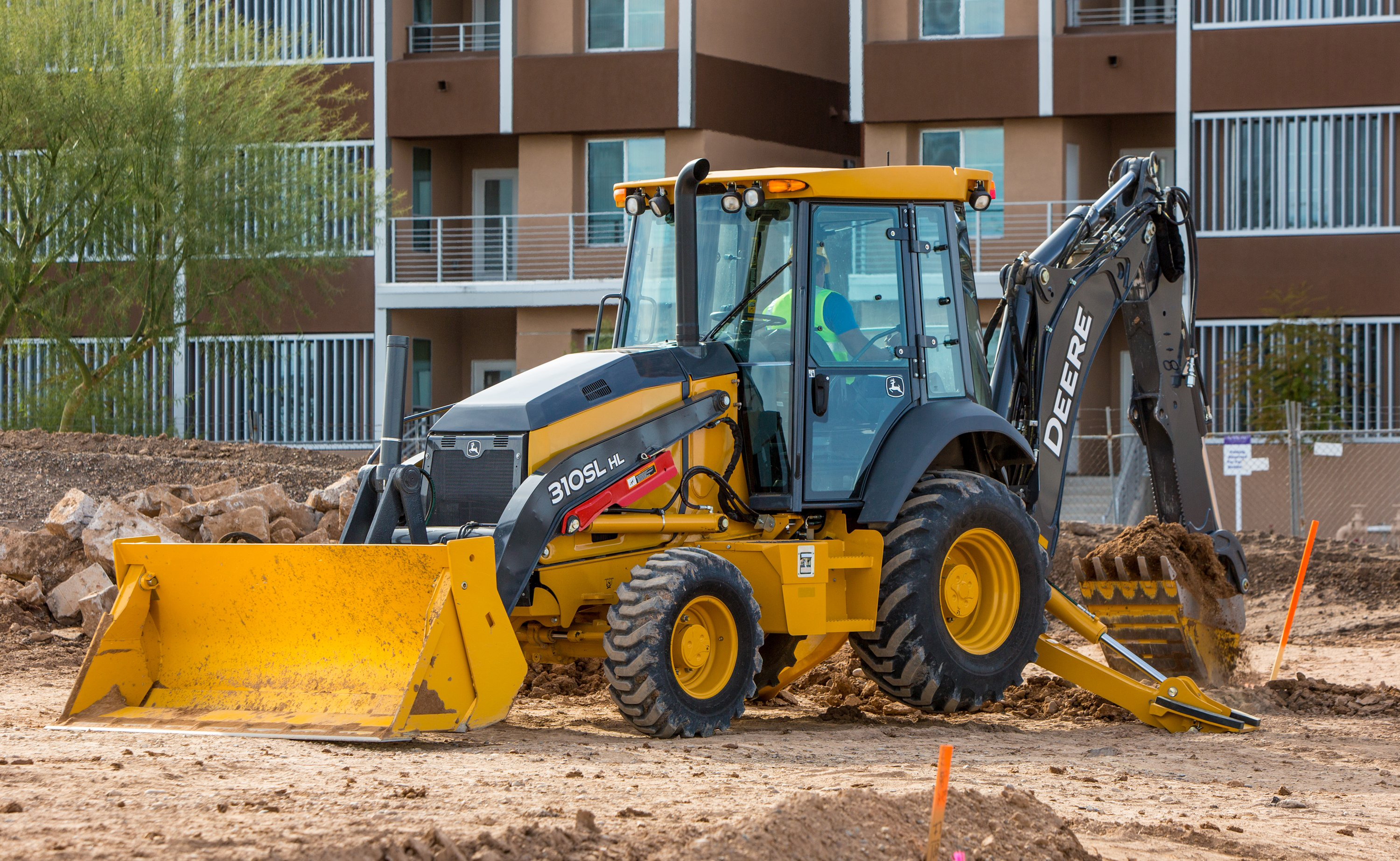 The 310SL HL can deliver up to 25 percent more backhoe-lift capacity ...