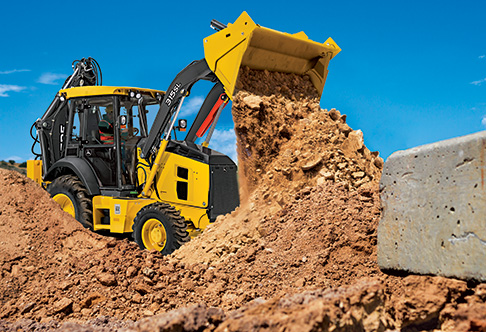 Right side view of the 315SL Backhoe Loader with bucket raised and ...