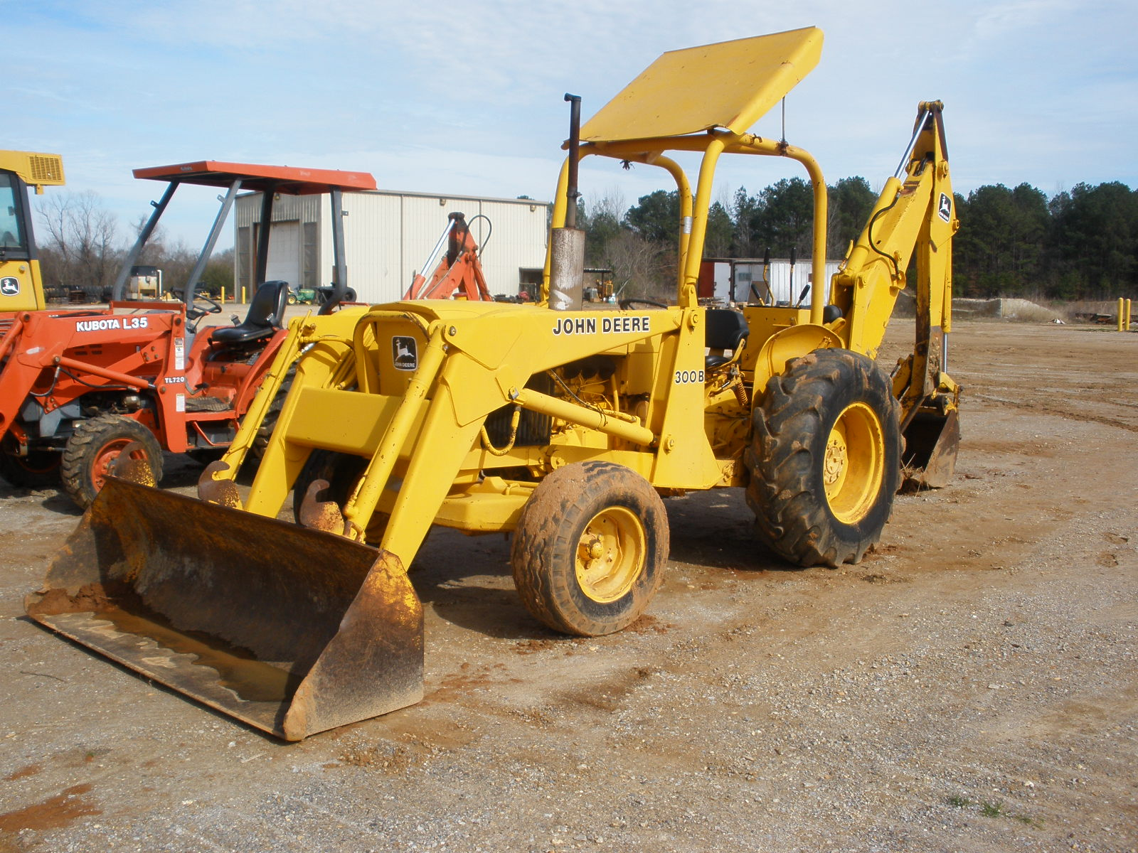 John Deere 300B Backhoe Specifications submited images.