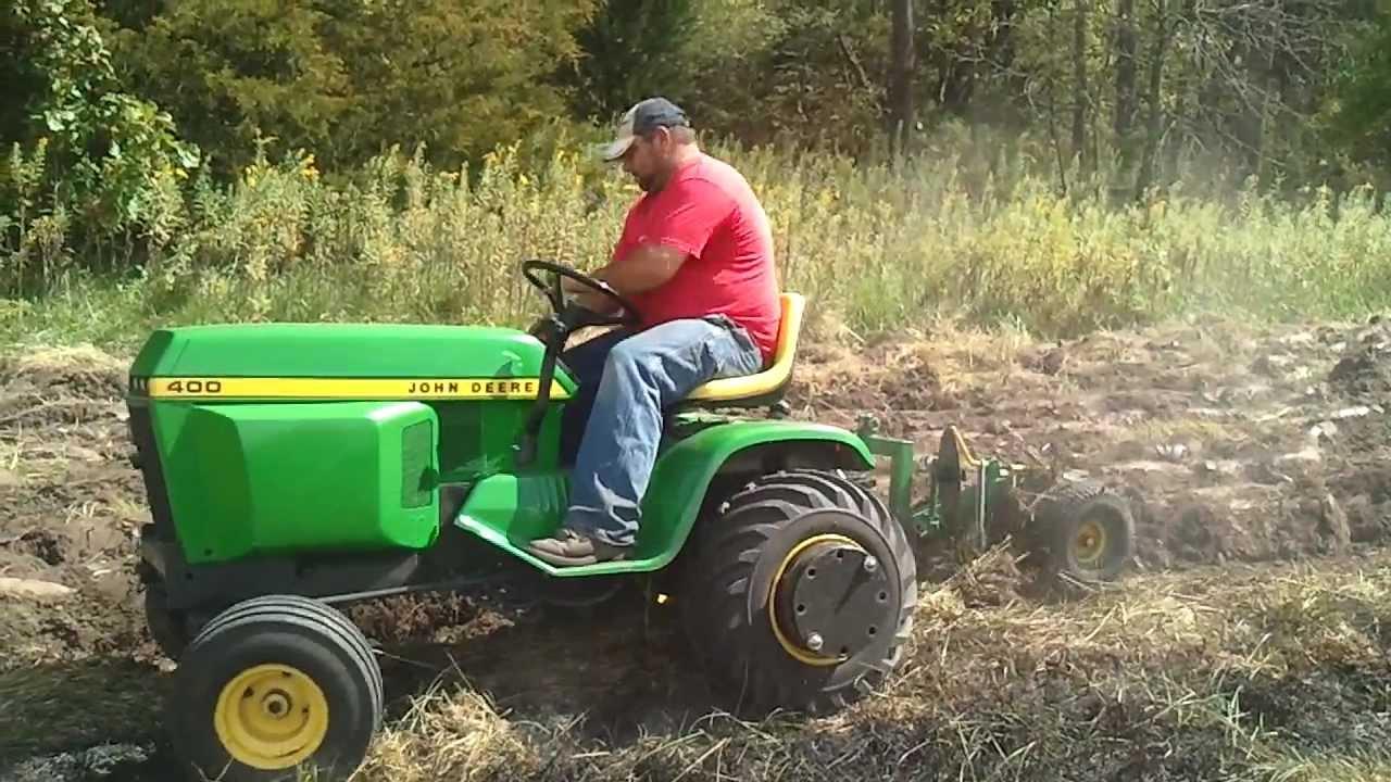 john deere 400 plowing sod - YouTube