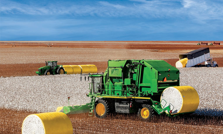 The new cotton stripper harvesting a field of cotton
