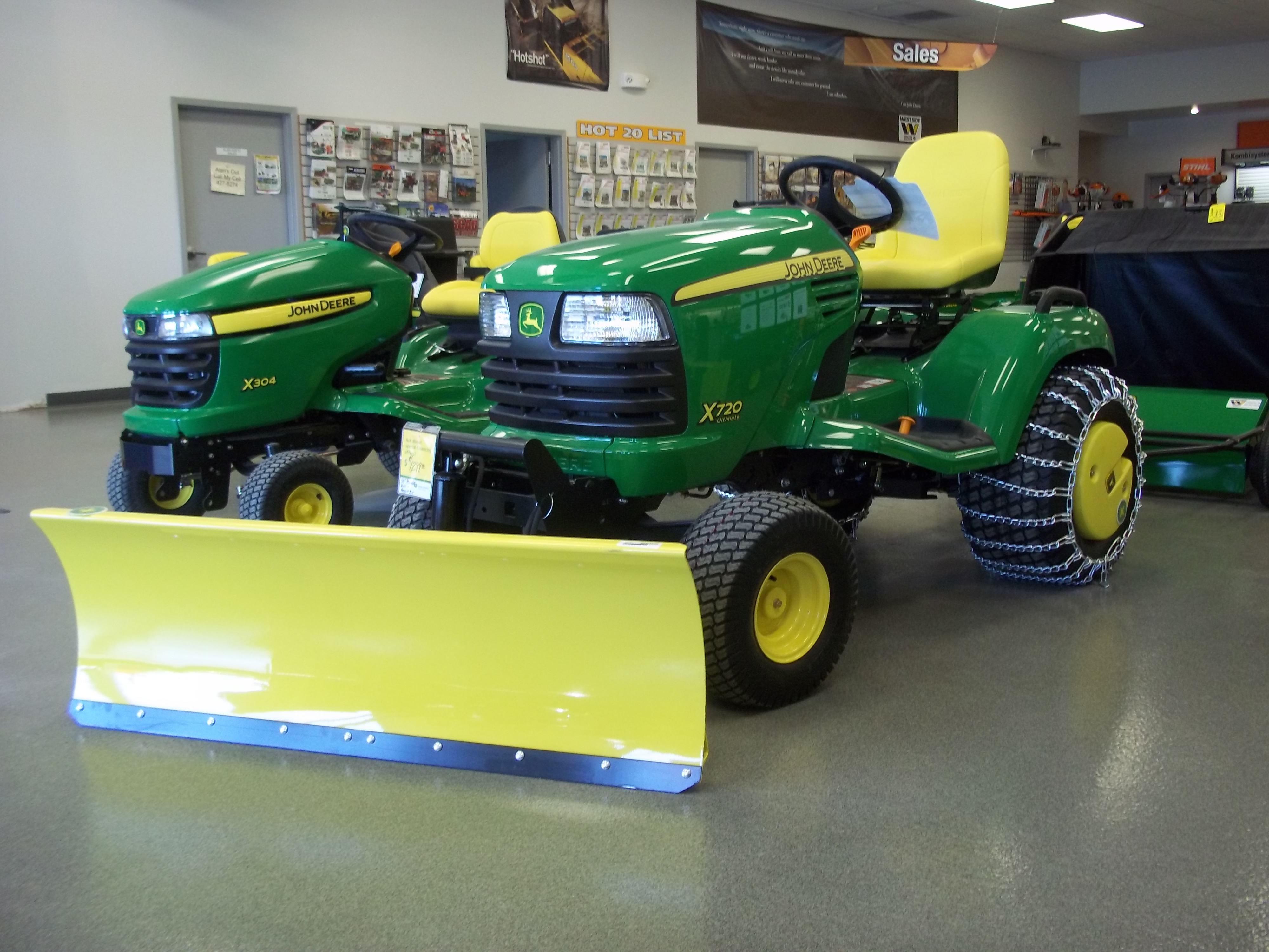 X700 Series tractor on right | John Deere equipment ...