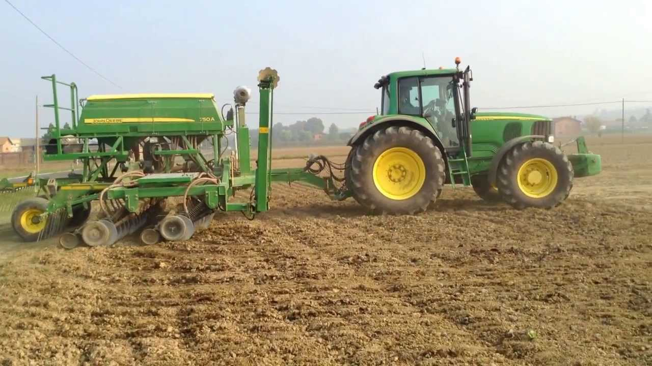 John Deere 750A drilling forage rye into oil radish cover ...