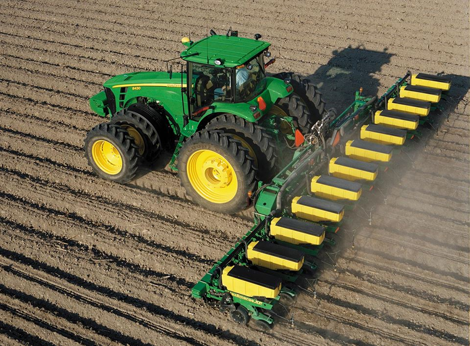 In 1957, John Deere six-row planter and cultivator ...