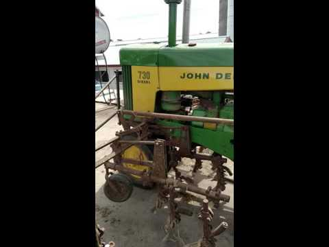 John Deere 730 with 6 row front mounted cultivator - YouTube