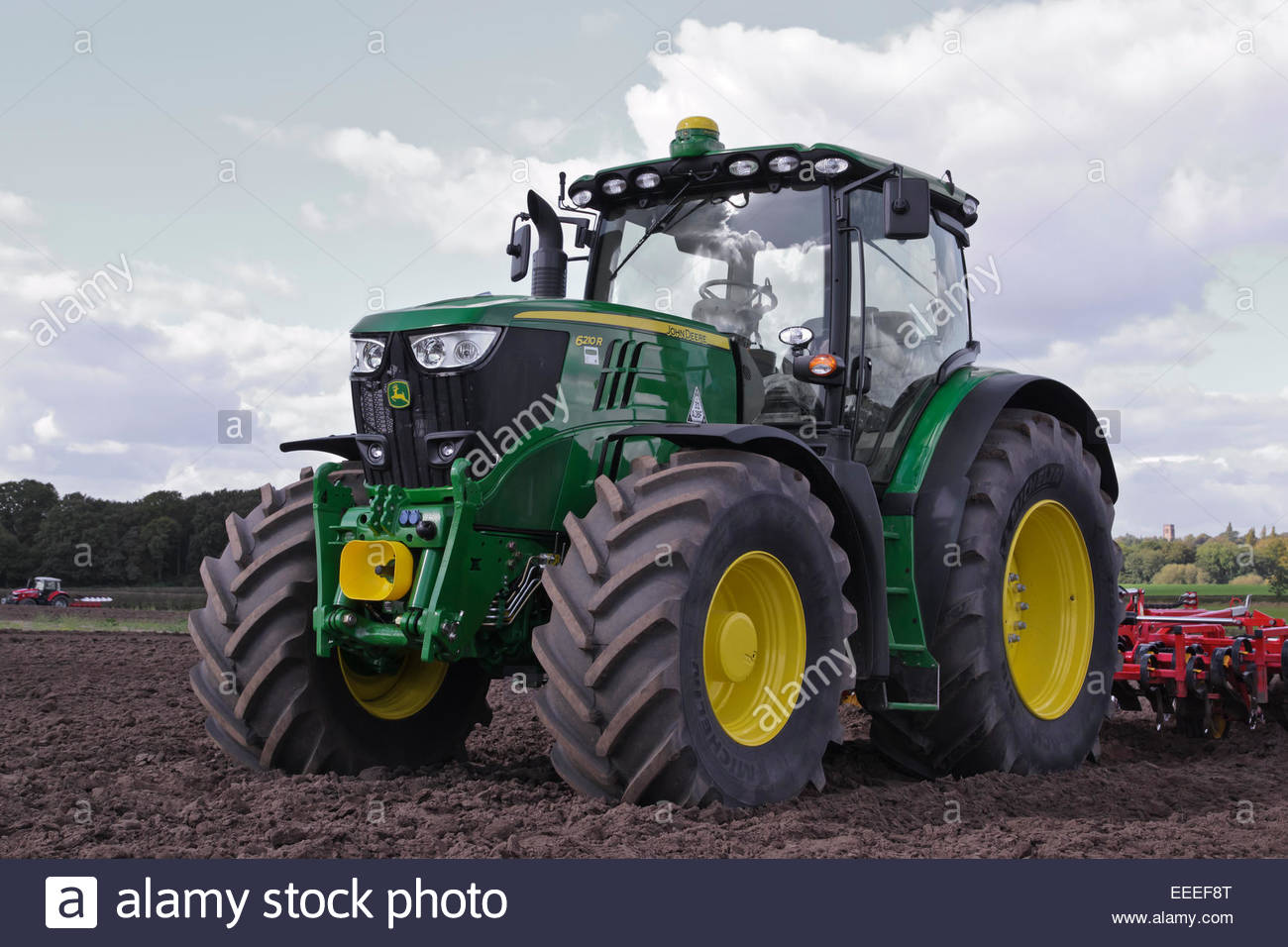 big john deere 6210r tractor with soil cultivator Stock ...