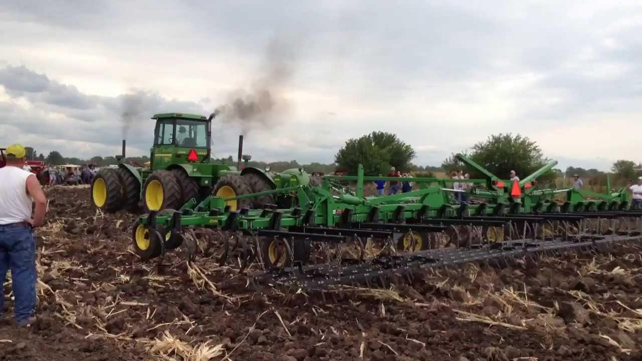 Three John Deere 830s pulling a 45 foot field cultivator ...