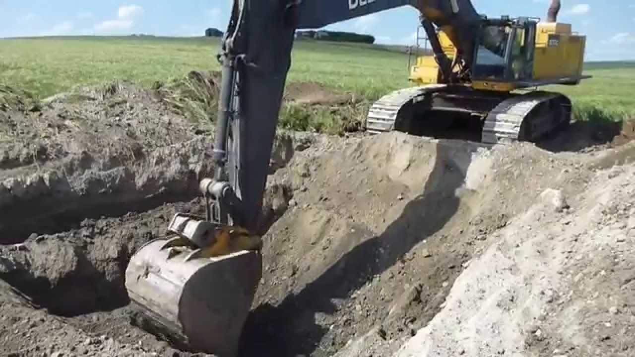 Lets dig a hole - John Deere 870G - YouTube