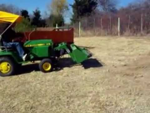 John Deere 318 with Buford Bucket.wmv - YouTube