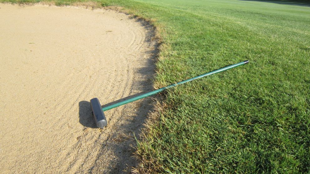 Should you leave the rake in or out of a bunker on the ...