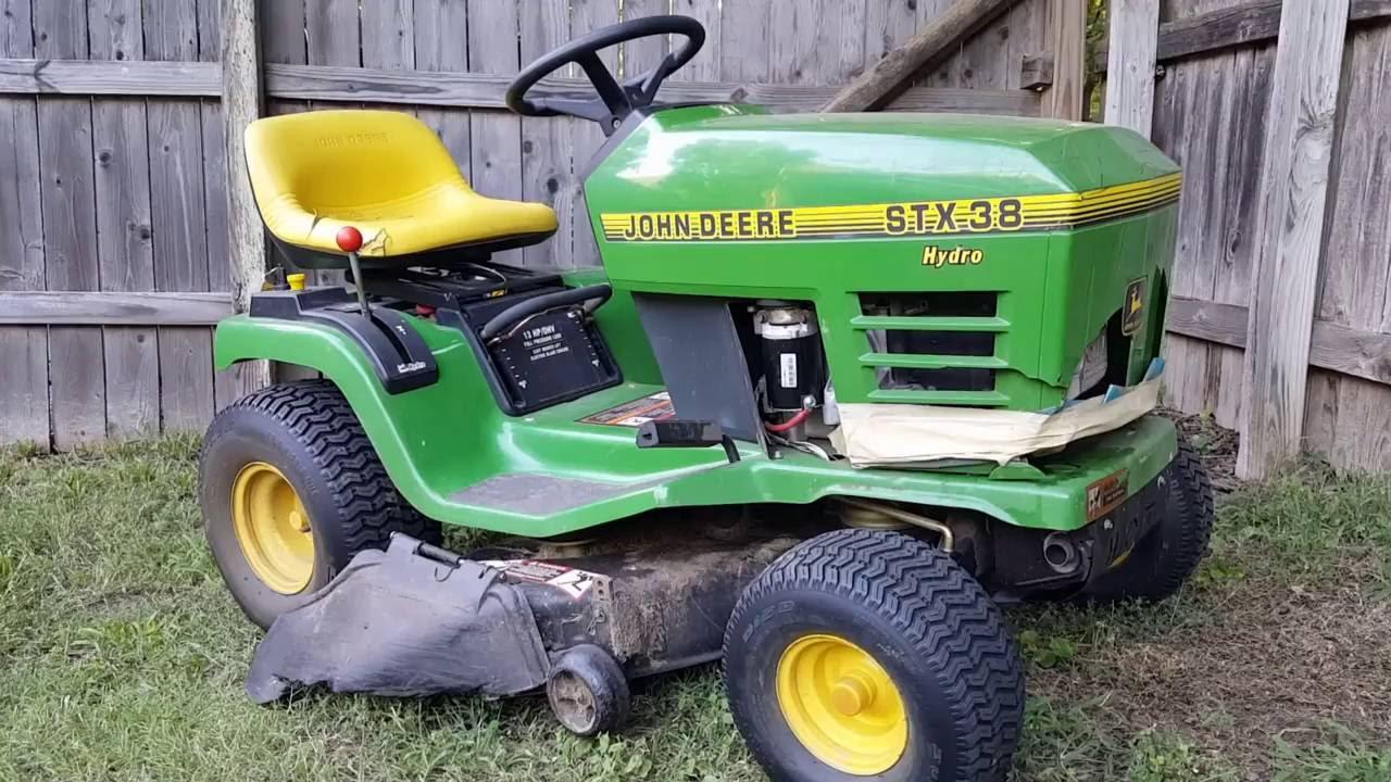 John deere stx38 riding mower starter replacement. - YouTube