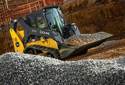 Right hand view of a 317G Compact Track Loader transporting gravel at ...