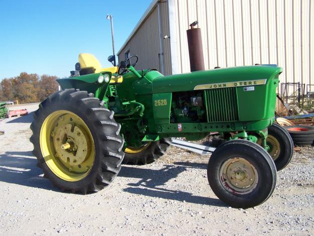 The pair of low hour John Deere 2520 diesel tractors.
