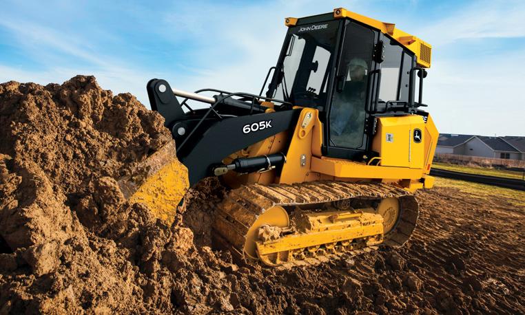Crawler loader digging dirt at a job site