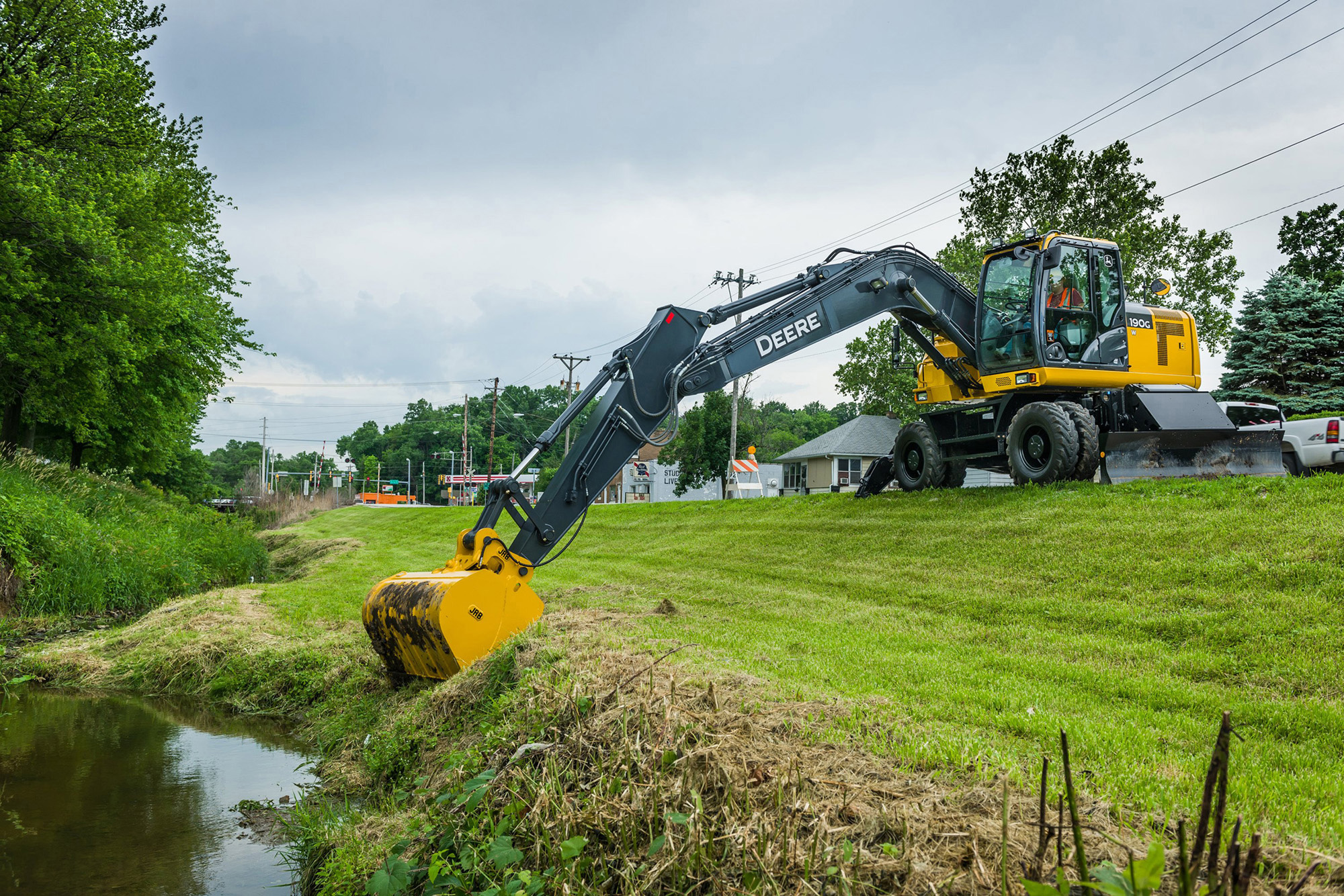 John Deere 190G W and 230G W Wheeled Excavators Bring Mobility to ...