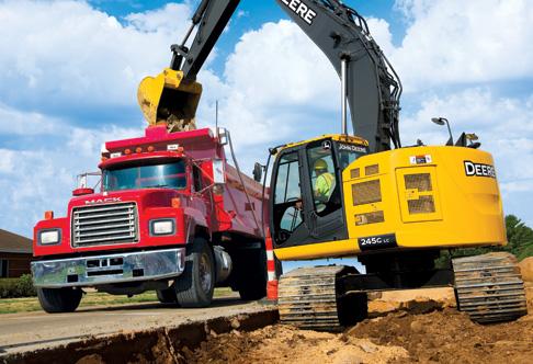 245G LC Excavator dumping concrete debris into a dump truck