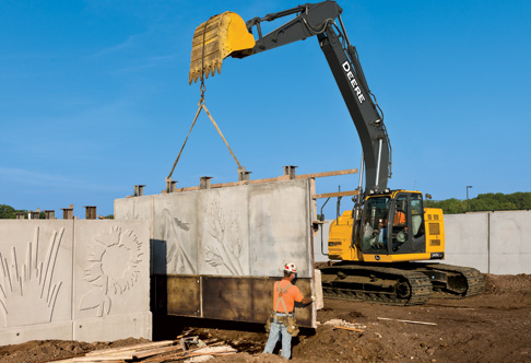 245G LC Excavator lifting large concrete panels for a highway ...