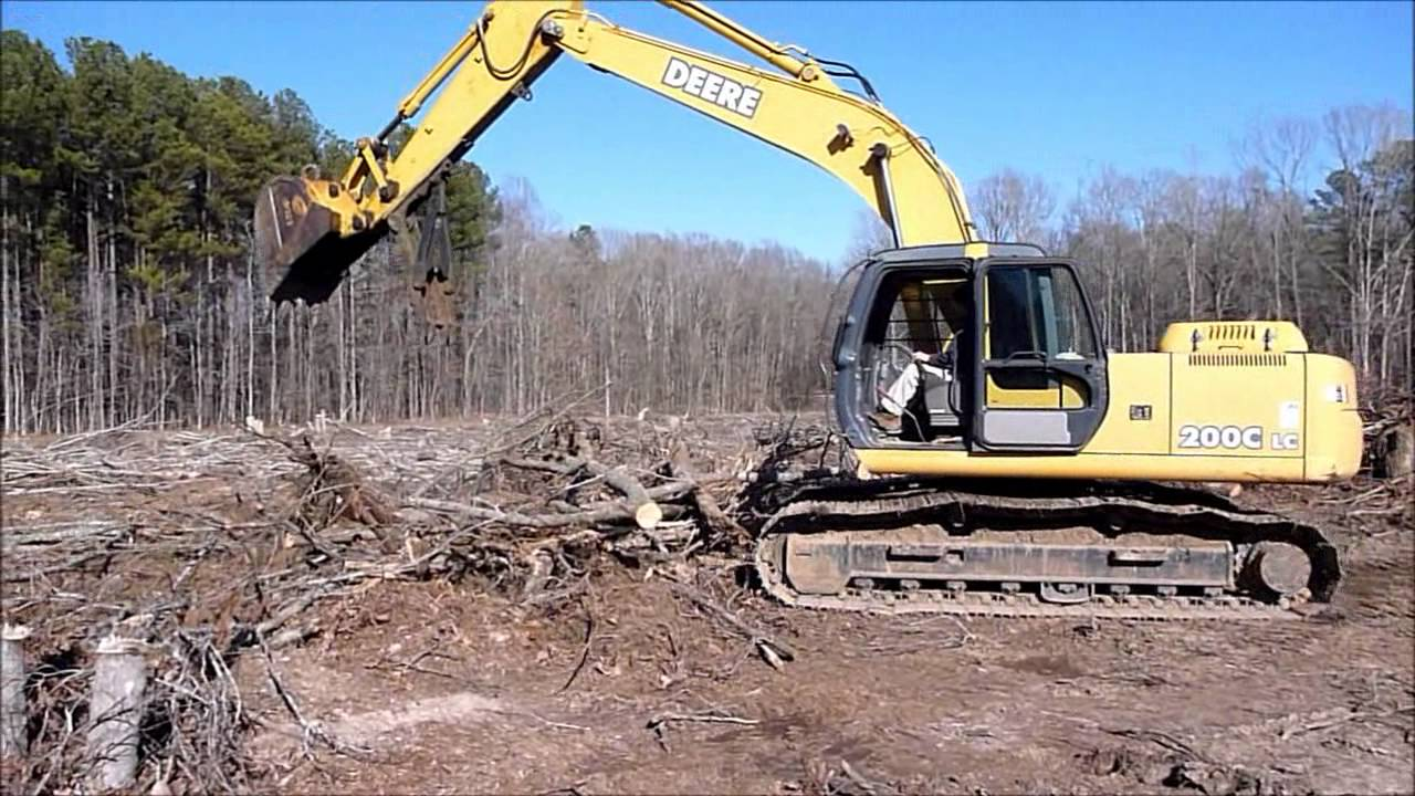 John Deere 200 excavator stacking brush - YouTube