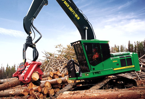 Overhead view of the 2154D Forestry Swing Machine cutting logs