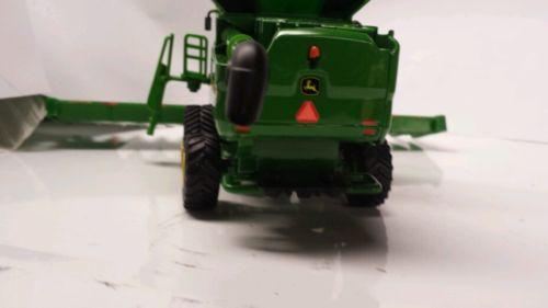 64 ERTL custom John deere S690 combine with tracks with 16 row head ...
