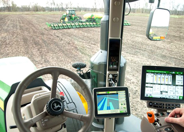 View from the inside of a John Deere tractor cab with displays and ...