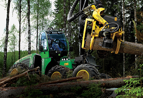 1170E Harvester with H754 harvesting head after sawing tree