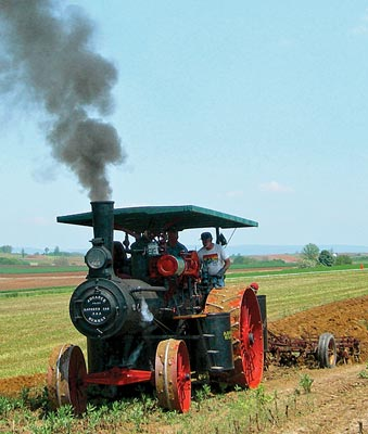 ... Plows by on Advance-Rumely as Sibling on Keck-Gonnerman Gets Stuck