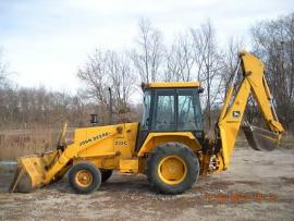 Equipment Movers John Deere 210C to Maxbass