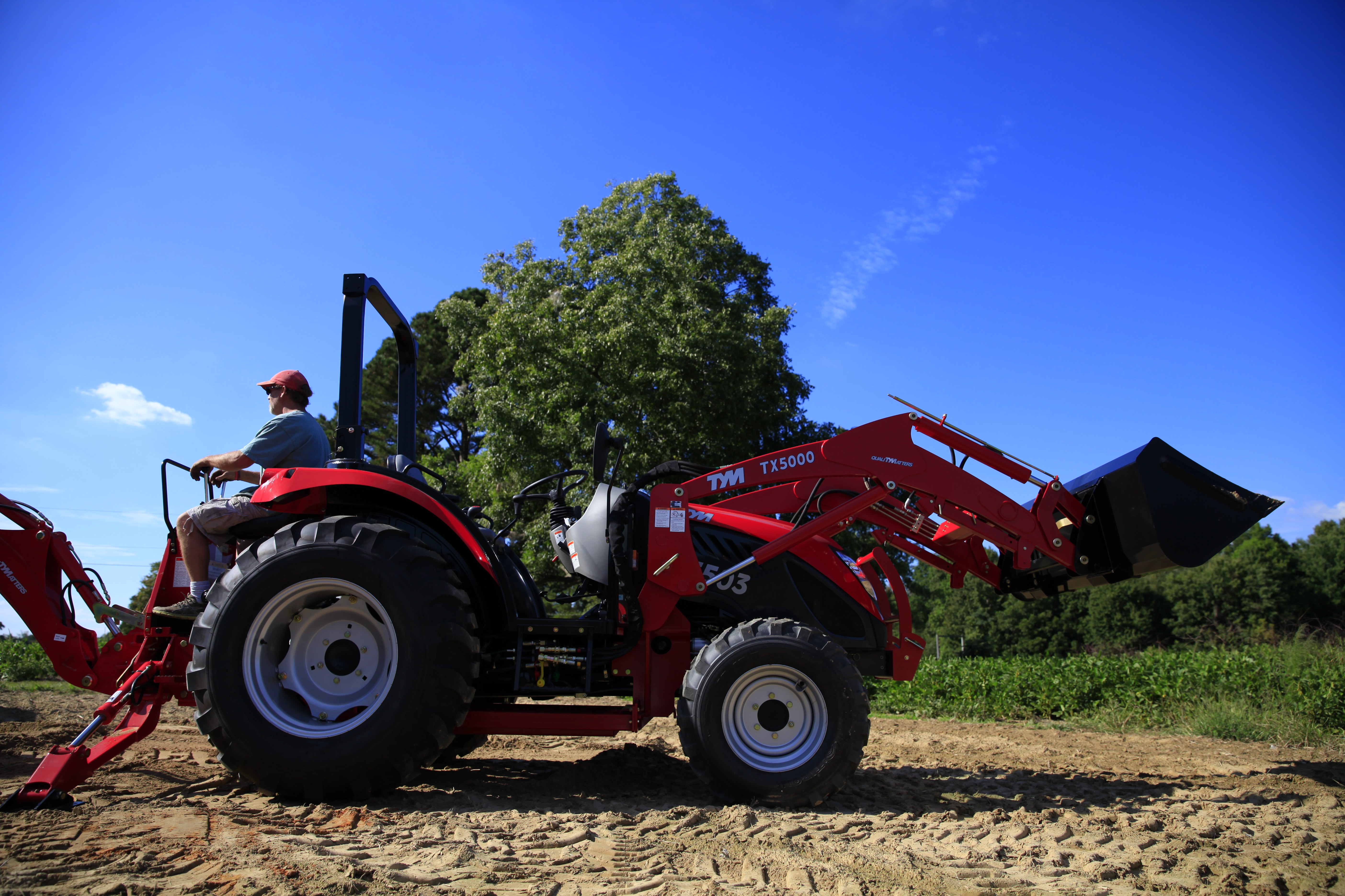 T503 compact tractor with a TX5000 front-end loader attachment and a ...