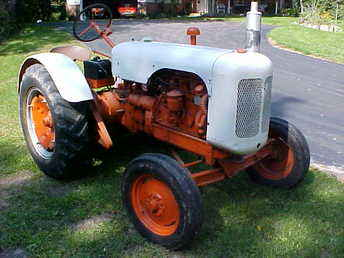 ... TRACTOR. RUNS GOOD. GOOD PAINT, TIRES & SHEET METAL. 4-CYLINDER LE ROI