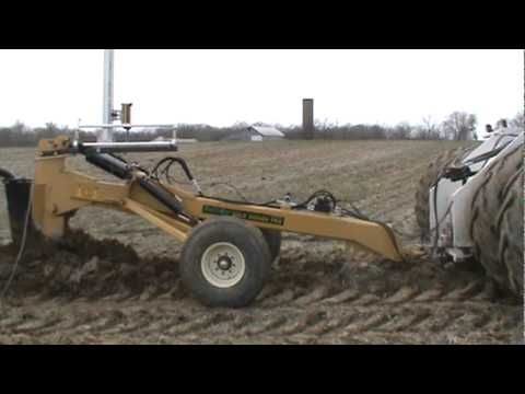 Big Bud 450-50 pulling a Gold Digger tile plow - YouTube